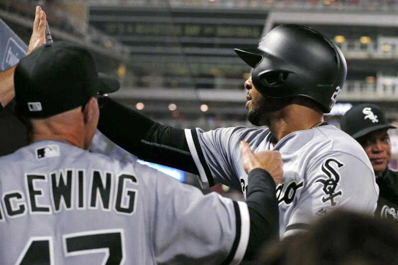 Chicago White Sox's Leury Garcia, right, is greeted in the dugout after scoring against the Minnesota Twins in the third inning of a baseball game Friday, April 14, 2017, in Minneapolis. (AP Photo/Jim Mone)