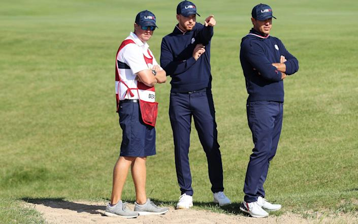 Berger and Koepka line up a shot on the 15th - Getty Images