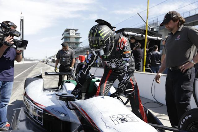 Race driver Kurt Busch climbs into his car during practice at the Indianapolis Motor Speedway during the Rookie Orientation Program in Indianapolis, Tuesday, April 29, 2014. Busch will try to be the first driver in a decade to compete in IndyCar's Indianapolis 500 and Sprint Cup's Coca-Cola 600 on the same day. (AP Photo/Michael Conroy)