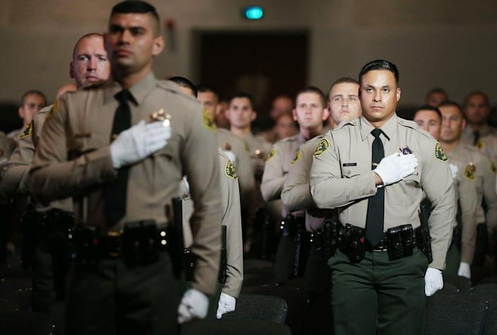 """<span class=""""caption"""">A Los Angeles County police graduation ceremony, Aug. 21, 2020 in Monterey Park, Calif. </span> <span class=""""attribution""""><a class=""""link rapid-noclick-resp"""" href=""""https://www.gettyimages.com/detail/news-photo/graduates-of-los-angeles-county-sheriffs-department-academy-news-photo/1267562794?adppopup=true"""" rel=""""nofollow noopener"""" target=""""_blank"""" data-ylk=""""slk:Mario Tama/Getty Images"""">Mario Tama/Getty Images</a></span>"""