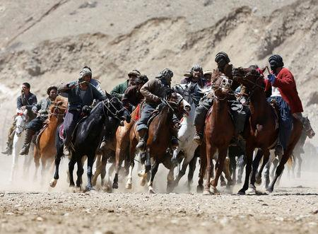 Afghan horsemen compete during a Buzkashi game in Panjshir province, north of Kabul, Afghanistan April 7, 2017.  REUTERS/Omar Sobhani