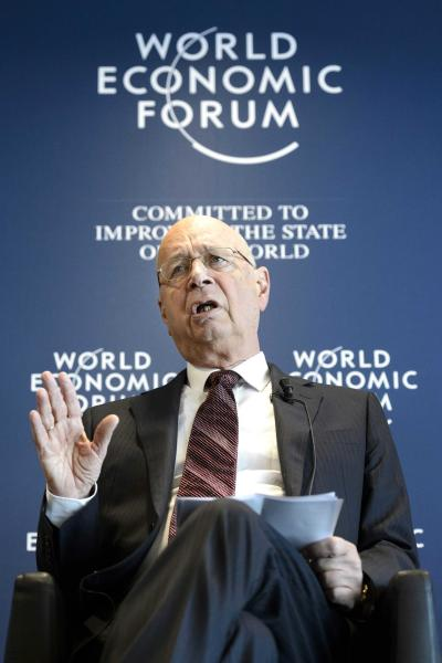 German Klaus Schwab, founder and president of the World Economic Forum, WEF, gestures during a press conference, in Cologny near Geneva, Switzerland, Wednesday, Jan. 16, 2013. The World Economic Forum today unveiled the programme for its Annual Meeting in Davos, Switzerland, including the key participants, themes and goals. The Meeting, will take place from Jan. 23 to Jan. 27, 2013 . (AP Photo/Keystone/Laurent Gillieron)