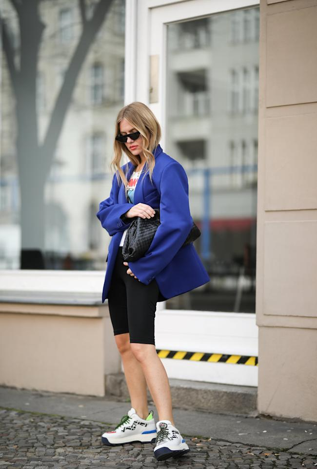 <p>Give your biker shorts a sleek touch with a Bottega clutch.</p>