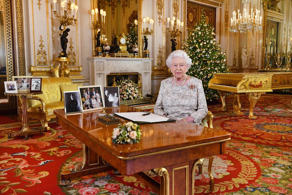 LONDON, UNITED KINGDOM - DECEMBER 25: Queen Elizabeth II poses for a photo after she recorded her annual Christmas Day message, in the White Drawing Room at Buckingham Palace in a picture released on December 25, 2018 in London, United Kingdom. (Photo by John Stillwell - WPA Pool/Getty Images)