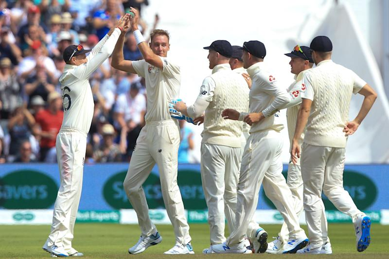 England's Stuart Broad (2L) celebrates with England's captain Joe Root (L) after taking the wicket of Australia's Cameron Bancroft for 8 runs during play on the opening day of the first Ashes cricket Test match between England and Australia at Edgbaston in Birmingham, central England on August 1, 2019. (Photo by Lindsey Parnaby / AFP) / RESTRICTED TO EDITORIAL USE. NO ASSOCIATION WITH DIRECT COMPETITOR OF SPONSOR, PARTNER, OR SUPPLIER OF THE ECB (Photo credit should read LINDSEY PARNABY/AFP/Getty Images)