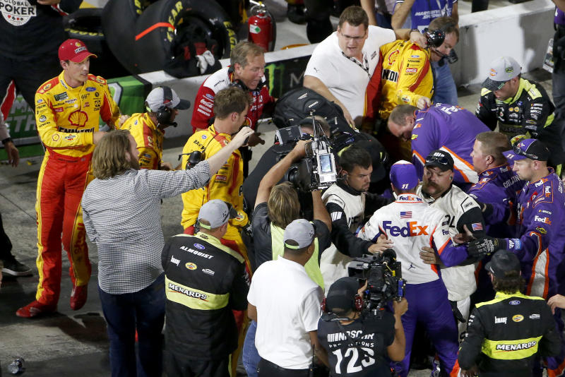 MARTINSVILLE, VIRGINIA - OCTOBER 27: Denny Hamlin, driver of the #11 FedEx Freight Toyota, Joey Logano, driver of the #22 Shell Pennzoil Ford, and their crews have an altercation on pit lane following the Monster Energy NASCAR Cup Series First Data 500 at Martinsville Speedway on October 27, 2019 in Martinsville, Virginia. (Photo by Brian Lawdermilk/Getty Images)