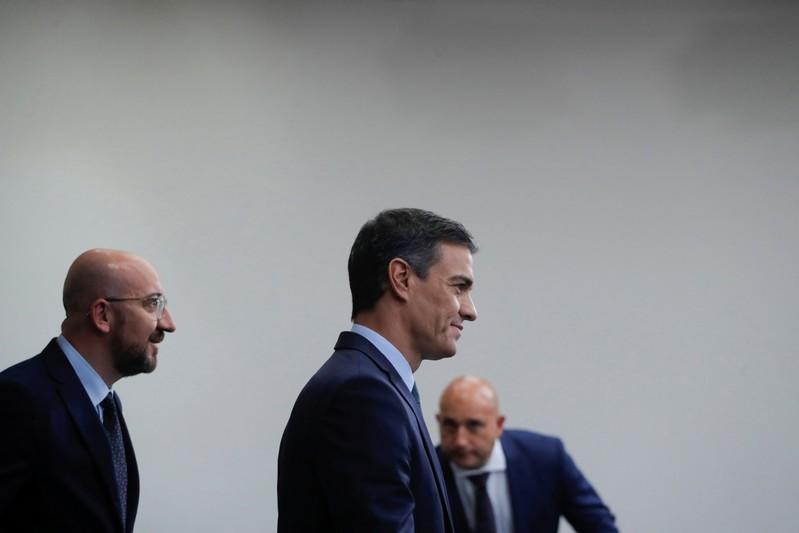 Spain's acting Prime Minister Pedro Sanchez and European Council president-elect Charles Michel arrive for a news conference at the Moncloa Palace, in Madrid