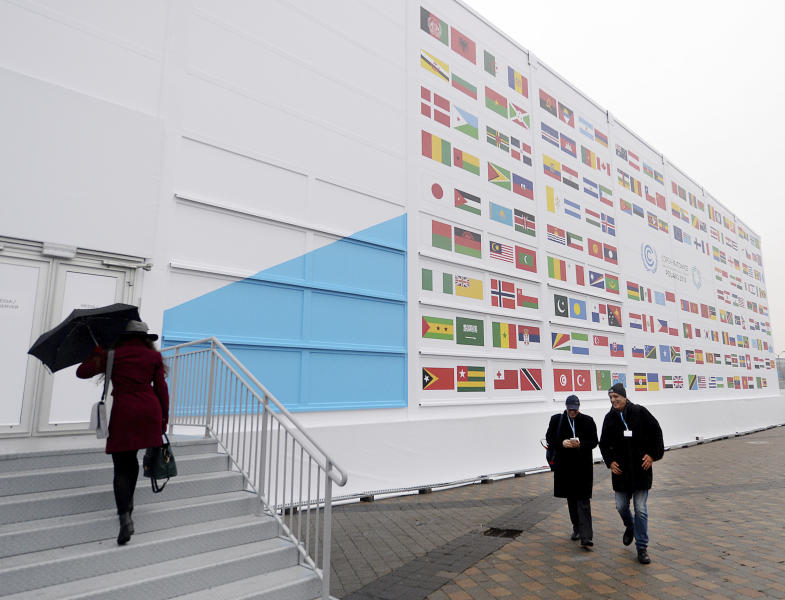 Guests arrive at the 'Spodek' multipurpose arena complex during to the COP24 summit in Katowice, Poland, Tuesday, Dec. 4, 2018. (AP Photo/Czarek Sokolowski)