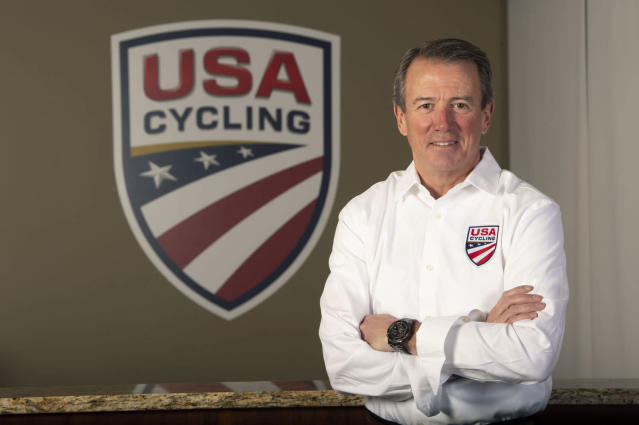 In this image provided by USA Cycling, Rob DeMartini, CEO of USA Cycling, poses at his offices in Colorado Springs, Colo. One year into his tenure at USA Cycling, Rob DeMartini is pushing the sport's governing body in a new direction. It will still support elite athletes, especially in the lead-up to the 2020 Summer Olympics in Tokyo. But it intends to take a bigger and more visible role in the growth of cycling at all levels. (Casey B. Gibson/USA Cycling via AP)