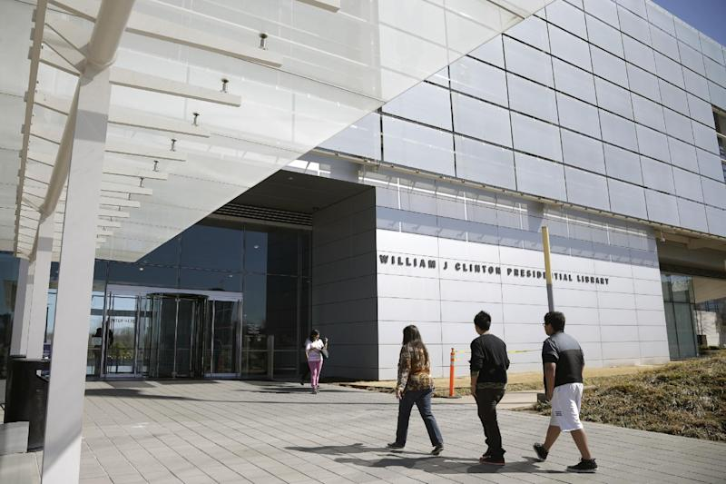 In this photo taken Thursday, March 13, 2014, visitors walk to the Clinton Presidential Library in Little Rock, Ark. The National Archives is scheduled to release thousands of pages of documents from Bill Clinton's administration Friday March 28, 2014. (AP Photo/Danny Johnston)