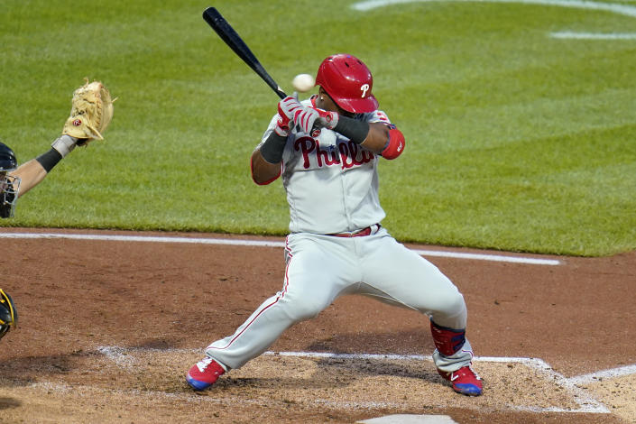 Philadelphia Phillies' Jean Segura ducks out of the way of an inside pitch from Pittsburgh Pirates' JT Brubaker during the fifth inning of a baseball game in Pittsburgh, Saturday, July 31, 2021. (AP Photo/Gene J. Puskar)
