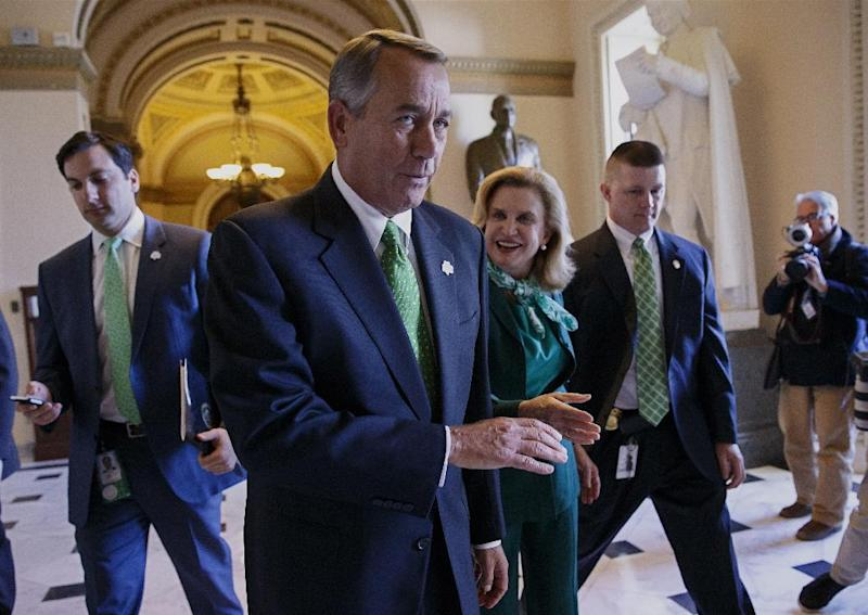 After being greeted by Rep. Carolyn Maloney, D-NY, center right, House Speaker John Boehner of Ohio leaves the House chamber on Capitol Hill in Washington, Friday, March 14, 2014, where the Republican-controlled House voted for the 51st time in 26 months to neuter the nation's health care law. With the vote 238-181 and nearly all Democrats opposed, the bill now goes to the Senate, where it's expected to die. The measure would overhaul the system for paying doctors and others who treat Medicare patients. At the same time, it delays the penalty for failing to purchase coverage under the law. (AP Photo/J. Scott Applewhite)