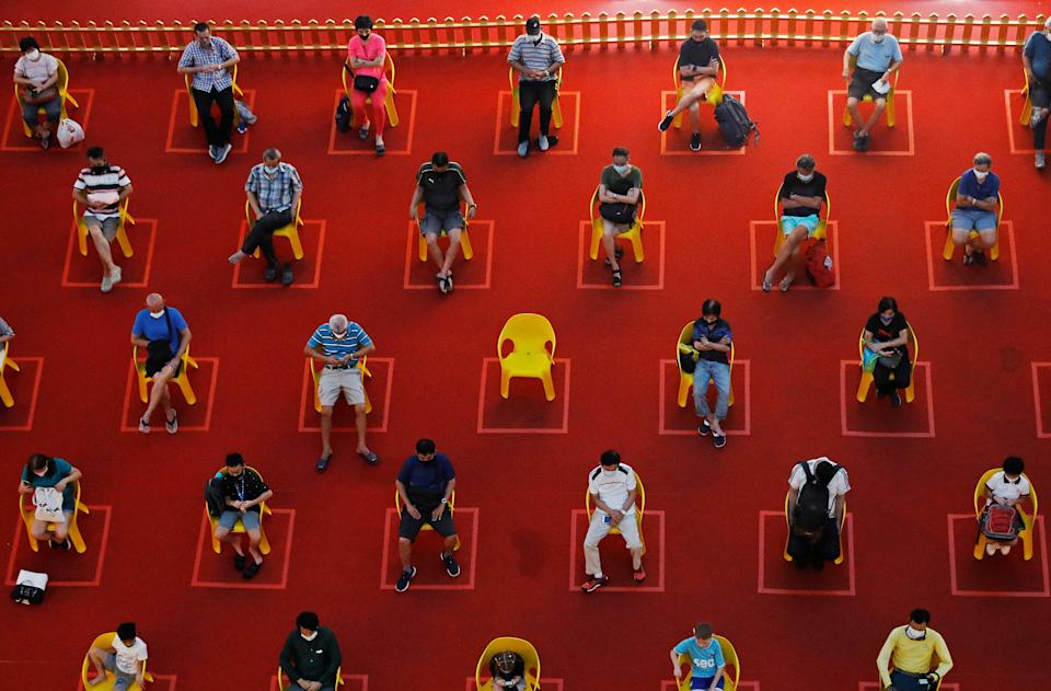 People watch an outdoor movie screening within their social distances during the coronavirus disease (COVID-19) outbreak in Singapore January 7, 2021. REUTERS/Edgar Su