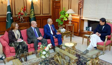 Pakistani Prime Minister Imran Khan speaks with U.S. special envoy Zalmay Khalilzad during a meeting at the Prime Minister's office in Islamabad