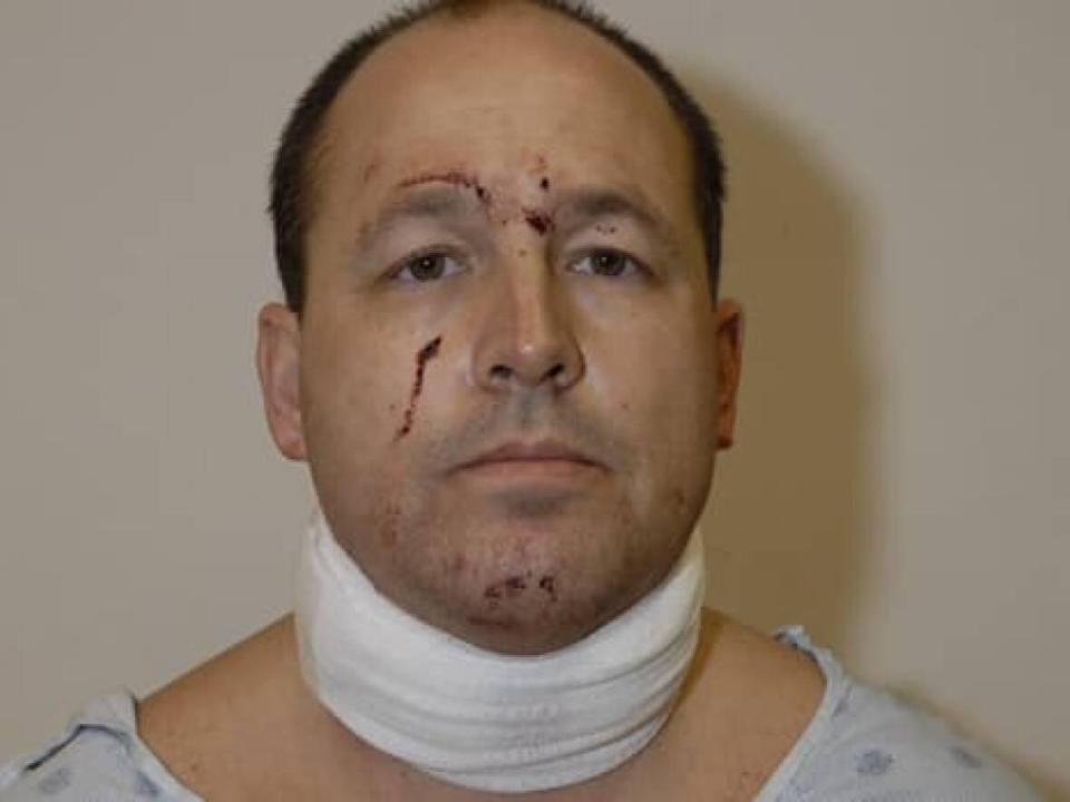 Kevin Gregson, seen here after his arrest on Dec. 29, 2009, said he was after Eric Czapnik's gun when he attacked him. (Ottawa Police Service - image credit)