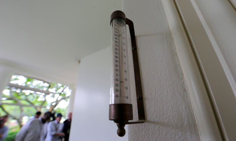A thermometer is seen mounted just outside the windows of the Oval Office for the President at the White House in Washington