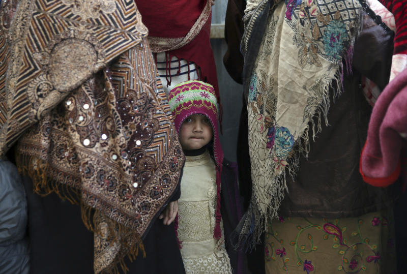 Family members of Islamic State militants either arrested or surrounded up to the Afghan government are presented to media in Kabul, Afghanistan, Saturday, Dec. 21, 2019.  The country's intelligence service says Saturday that there are more than 75 women and 159 children most of them form foreign countries in the custody of the agency known as the National Deteriorate for Security.  (AP Photo/Rahmat Gul)