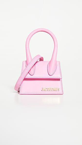 """<p><strong>Jacquemus</strong></p><p>shopbop.com</p><p><strong>$520.00</strong></p><p><a href=""""https://go.redirectingat.com?id=74968X1596630&url=https%3A%2F%2Fwww.shopbop.com%2Fchiquito-jacquemus%2Fvp%2Fv%3D1%2F1538882754.htm&sref=https%3A%2F%2Fwww.townandcountrymag.com%2Fstyle%2Ffashion-trends%2Fg36421997%2Fcolorful-summer-outfit-ideas%2F"""" rel=""""nofollow noopener"""" target=""""_blank"""" data-ylk=""""slk:Shop Now"""" class=""""link rapid-noclick-resp"""">Shop Now</a></p><p>The best things come in teeny tiny packages. This Jacquemus purse won't hold much, but the compliments will be plentiful. </p>"""