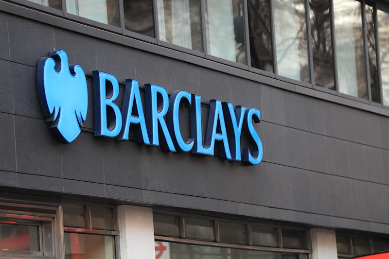 A view of a sign for a Barclays bank in London.