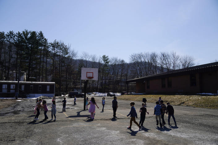 Students play outside during recess at the Panther Valley Elementary School, Thursday, March 11, 2021, in Nesquehoning, Pa. On May 26, 2020, former student, 9-year-old Ava Lerario; her mother, Ashley Belson, and Ava's father, Marc Lerario were found fatally shot inside their home. (AP Photo/Matt Slocum)