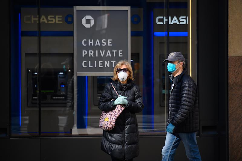 NEW YORK, NY - MARCH 27: People are seen wearing protective face masks outside Chase Bank in Murray Hill as the coronavirus continues to spread across the United States on March 27, 2020 in New York City. The World Health Organization declared coronavirus (COVID-19) a global pandemic on March 11th. (Photo by Noam Galai/Getty Images)