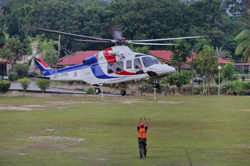 A police helicopter arrives to retrieve a body that was found in the jungle near Seremban August 13, 2019. — Picture by Ahmad Zamzahuri