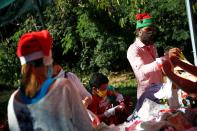"""Volunteers from the private initiative """"Santa in the street"""" sort donated clothes to be handed out to families in need, in Guarenas"""