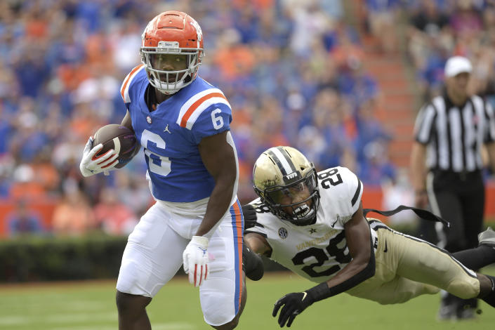 Florida running back Nay'Quan Wright (6) rushes for a 34-yard gain in front of Vanderbilt cornerback Allan George (28) during the first half of an NCAA college football game, Saturday, Oct. 9, 2021, in Gainesville, Fla. (AP Photo/Phelan M. Ebenhack)