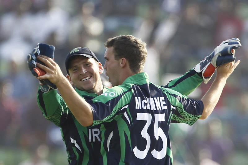 Ireland's Andy McBrine, right, celebrates with teammate Gary Wilson after taking the wicket of Zimbabwe's Sean Williams during their ICC Twenty20 Cricket World Cup match in Sylhet, Bangladesh, Monday, March 17, 2014. (AP Photo/A.M. Ahad)