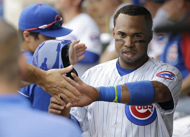 Chicago Cubs' Luis Valbuena (24) celebrates with teammates in the dugout after scoring on a single by Logan Watkins during the second inning of an interleague baseball game against the Baltimore Orioles in Chicago, Saturday, Aug. 23, 2014. (AP Photo/Nam Y. Huh)
