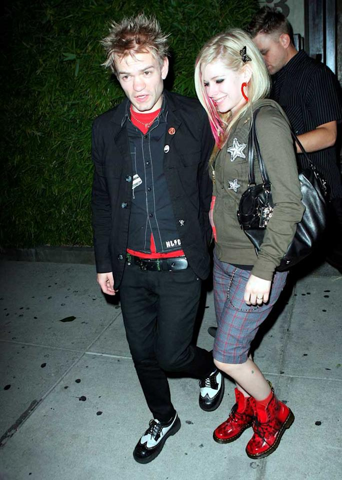 "Avril Lavigne (pictured here leaving Koi with husband Deryck Whibley) may not be performing anytime soon - at least in Malaysia. The Southeast Asian nation's Islamic opposition party urged the government to cancel the Canadian singer's concert on Monday, claiming her on-stage moves are ""too sexy."" <a href=""http://www.x17online.com"" target=""new"">X17 Online</a> - August 22, 2008"