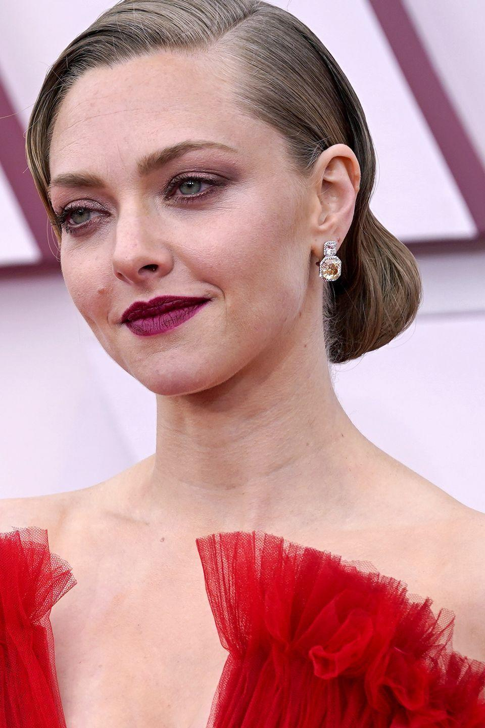 "<p>Seyfried's look was the picture of Golden Age Hollywood thanks to the handiwork of makeup artist Genevieve Herr. To complete the coordinated plummy-lip and eye, the artist used <a href=""https://www.sephora.com/product/monsieur-big-mascara-P419848"" rel=""nofollow noopener"" target=""_blank"" data-ylk=""slk:Lancome Monsieur Big Mascara"" class=""link rapid-noclick-resp"">Lancome Monsieur Big Mascara</a>.</p>"