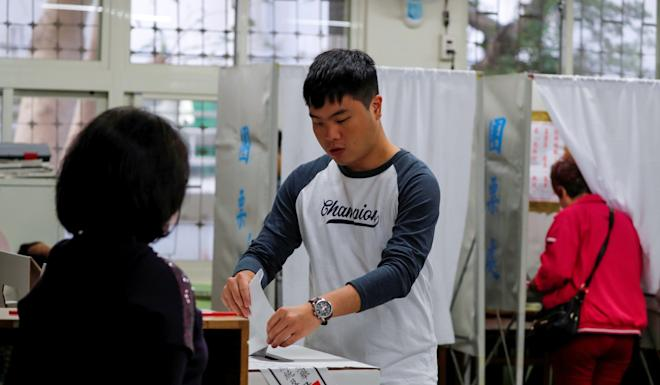 A man casts his ballot at a polling station during general elections in New Taipei City, Taipei, on Saturday. Photo: Reuters
