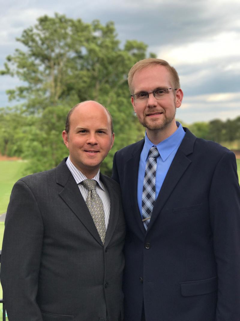 One high school fired a gay teacher. Another school protected one. They are married to each other