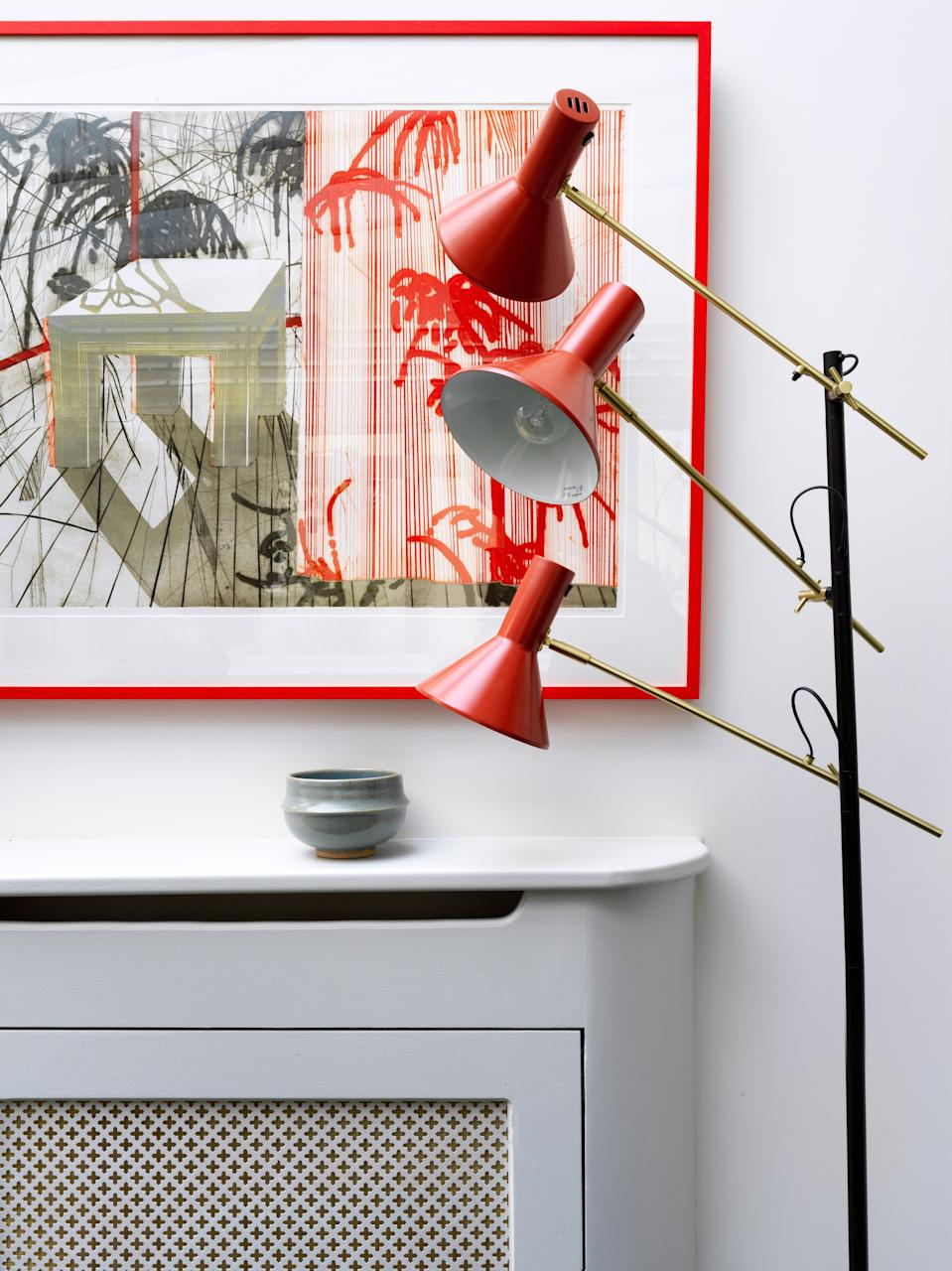The red lamp was a cheap find from Habitat in the U.K. and works well against the client's abstract artwork.