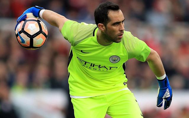 Claudio Bravo insists he is happy at Manchester City despite the club looking for another goalkeeper