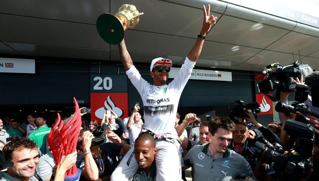 Lewis Hamilton celebrates after ending his wait for another British Grand Prix victory after triumphing in the 2014 race