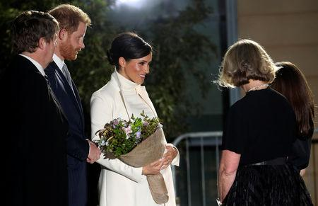Britain's Meghan, Duchess of Sussex, is greeted with flowers at the Natural History Museum with Prince Harry in London, Britain February 12, 2019. REUTERS/Hannah McKay