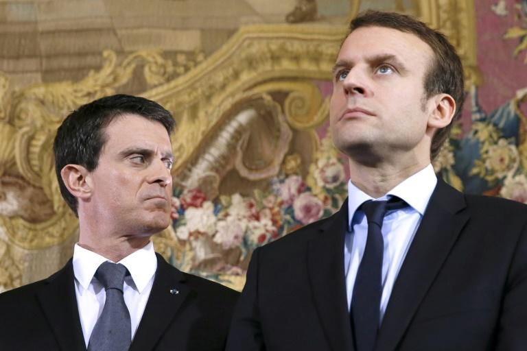 Manuel Valls (L) and Emmanuel Macron pictured when both were ministers for the Socialist Party in 2016