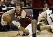 Miami Heat shooting guard Mike Miller, San Antonio Spurs point guard Cory Joseph and Matt Bonner, right, battle for a loose ball during the first half at Game 3 of the NBA Finals basketball series, Tuesday, June 11, 2013, in San Antonio. (AP Photo/Eric Gay)