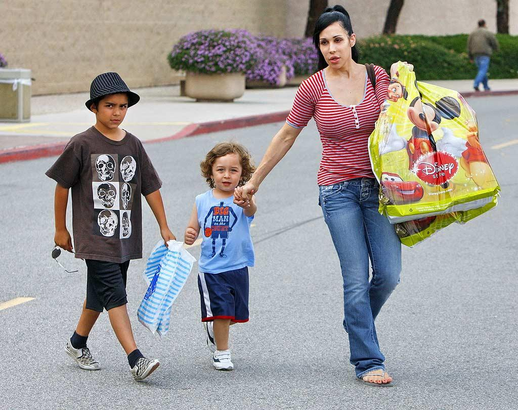 """Nadya Suleman (aka """"Octomom"""") celebrated her special day by hitting up a Disney store with a couple of her 14 kids in tow. Suleman recently admitted to Oprah that she regrets her decision to raise so many children as a single parent, calling her """"own childish desires … selfish and immature."""" Larsen/Tony/<a href=""""http://www.infdaily.com"""" target=""""new"""">INFDaily.com</a> - May 9, 2010"""
