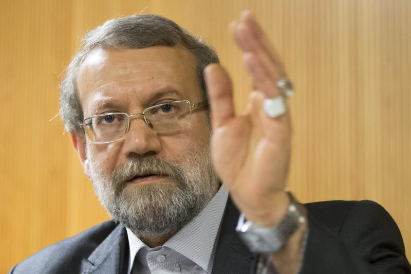 Iran's Parliament speaker Ali Larijani answers a question during a press conference on the sidelines of the 129th Assembly of the Inter-Parliamentary Union (IPU), in Geneva, Switzerland, Wednesday, Oct. 9, 2013. (AP Photo/Keystone, Salvatore Di Nolfi)
