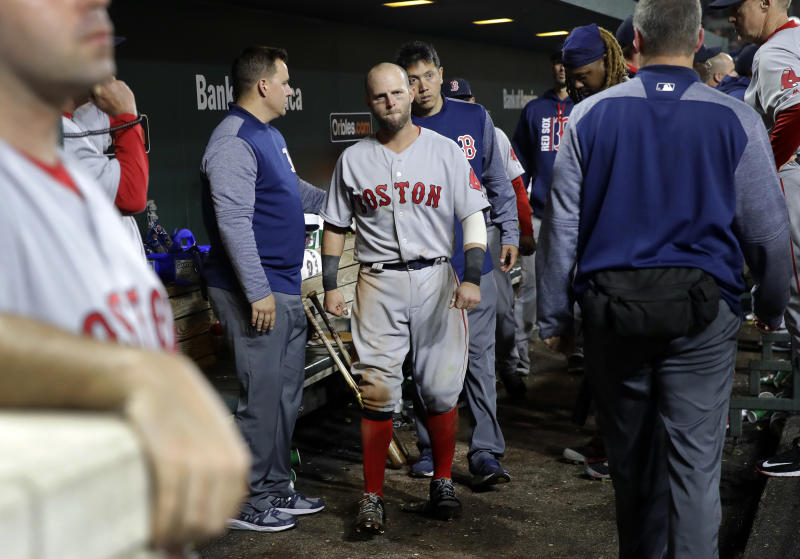 Boston Red Sox second baseman Dustin Pedroia, center, walks out of the dugout after being injured during the eighth inning of the team's baseball game against the Baltimore Orioles in Baltimore, Friday, April 21, 2017. (AP Photo/Patrick Semansky)