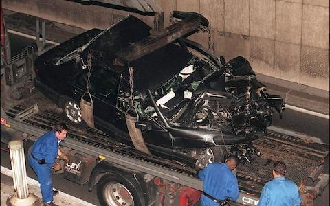 The mangled wreck of the Mercedes is removed from the scene of the Paris crash in 1997. - Credit: Abaca / FlynetPictures.co.uk
