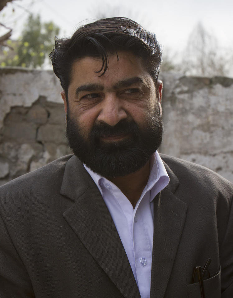 In this photo taken Thursday, March 8, 2012, Pakistani lawyer Qasi Anis Rahman talks to the Associated Press next to a house in Haripur, Pakistan, that Pakistan's intelligence agency believes Osama bin Laden lived in for nearly a year until he moved into the villa where he was eventually killed. Rahman is the brother of the widow who owns the house. in the frontier town of Haripur which was used by bin Laden while he waited for construction crews to finish his new home in the garrison town of Abbottabad, just 30 kilometers (18 miles) away. (AP Photo/Anjum Naveed)