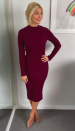"""<p>Who knew Holly was such a fan of high street brand, Bershka? Her burgundy number is priced at just £19.99 and is still in <a rel=""""nofollow noopener"""" href=""""https://www.bershka.com/gb/woman/clothing/dresses/ribbed-dress-with-button-neck-c1010193213p101097570.html?colorId=681"""" target=""""_blank"""" data-ylk=""""slk:stock"""" class=""""link rapid-noclick-resp"""">stock</a> so make sure to hurry… </p>"""