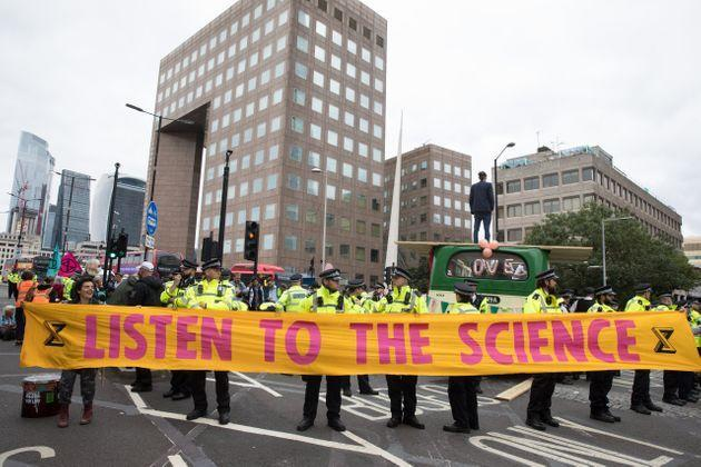Environmental activists from Extinction Rebellion hold a banner calling on the government to cease all new fossil fuel investment (Photo: Mark Kerrison via Getty Images)