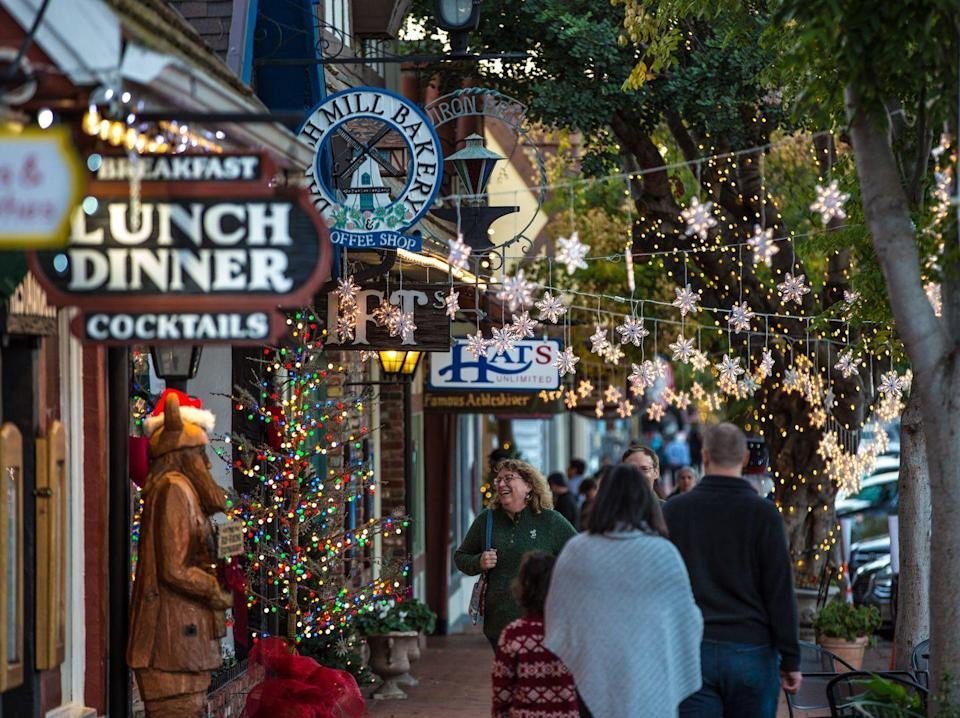 """<p>This town, right smack in the middle of California wine country, celebrates Christmas all December long with its <a href=""""https://www.solvangjulefest.org/"""" rel=""""nofollow noopener"""" target=""""_blank"""" data-ylk=""""slk:Julefest"""" class=""""link rapid-noclick-resp"""">Julefest</a>. The Danish-style celebration features a number of holiday experiences, like the Christmas Market Light Show, Tree-Lighting Ceremony, Julefest parade, and candlelight tours. </p>"""