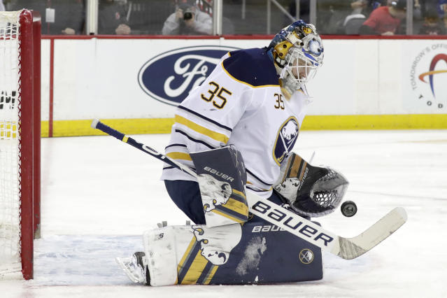 Buffalo Sabres goaltender Linus Ullmark, of Sweden, blocks a shot from the New Jersey Devils during the second period of an NHL hockey game, Monday, March 25, 2019, in Newark, N.J. (AP Photo/Julio Cortez)