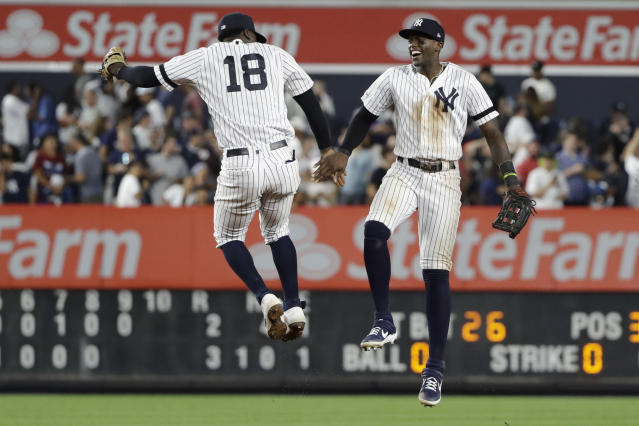 New York Yankees' Didi Gregorius, left, celebrates with Cameron Maybin after a baseball game against the Cleveland Indians, Friday, Aug. 16, 2019, in New York. (AP Photo/Frank Franklin II)